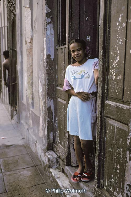 A girl in the doorway of her home in Central Havana (Havana Centro).