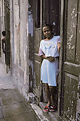 A girl in the doorway of her home in Central Havana (Havana Centro).