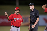AZL Angels manager Jack Santora (5) discusses a questionable call by field umpire Benjamin Engstrand during an Arizona League game against the AZL Athletics at Tempe Diablo Stadium on June 26, 2018 in Tempe, Arizona. The AZL Athletics defeated the AZL Angels 7-1. (Zachary Lucy/Four Seam Images)