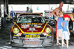 Fans check out race cars during the American Le Mans Race at the Circuit of the Americas race track in Austin,Texas.