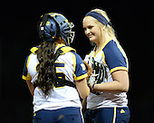 Michigan Wolverines Softball catcher Lauren Sweet (25) and pitcher Megan Betsa (3) during a game against the University of South Florida Bulls on February 8, 2014 at the USF Softball Stadium in Tampa, Florida.  Michigan defeated USF 3-2.  (Copyright Mike Janes Photography)