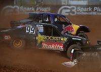 Apr 16, 2011; Surprise, AZ USA; LOORRS driver Kyle Leduc (99) races alongside Ricky Johnson (48) during round 3 at Speedworld Off Road Park. Mandatory Credit: Mark J. Rebilas-.