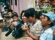 Danang, February 1988. Typical Amerasian teenagers that we can see everywhere handling small bussiness in the streets of the City.