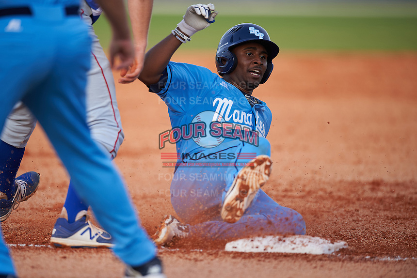 SCF Manatees Keshawn Lynch (2) slides into third after hitting a triple during a game against the College of Central Florida Patriots on February 8, 2017 at Robert C. Wynn Field in Bradenton, Florida.  SCF defeated Central Florida 6-5 in eleven innings.  (Mike Janes/Four Seam Images)
