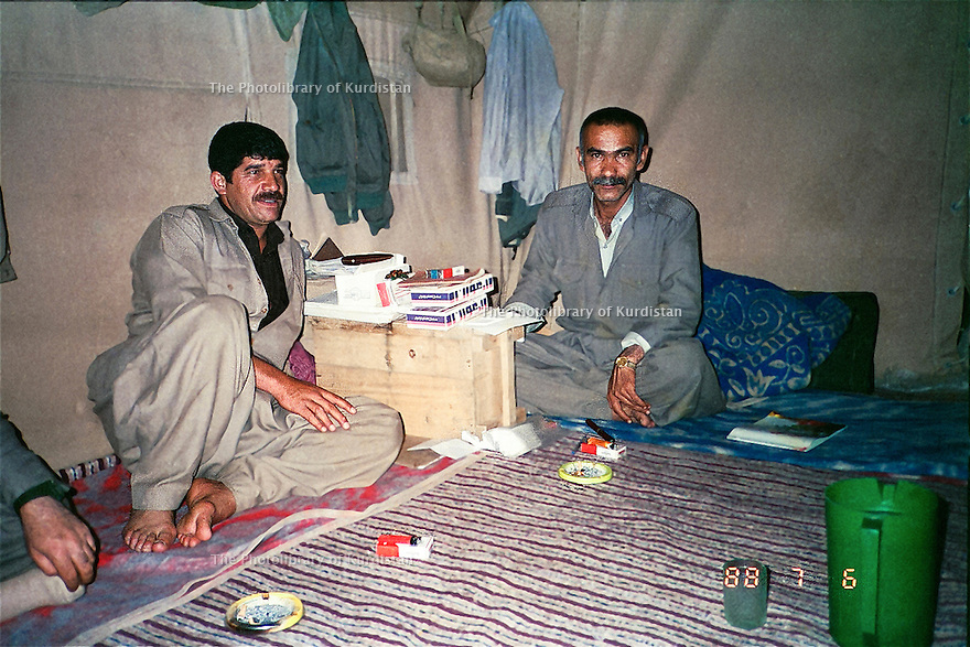 Iraq 1988 .Nou Shirwan Miustafa in his office, a tent, in the mountain in July with Mam Rostam.Irak 1988.Nou Shirwan Mustafa sous la tente lui servant de bureau dans la montagne avec Mam Rostam