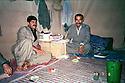 Iraq 1988 .Nawshirwan Mustafa in his office, a tent, in the mountain in July with Mam Rostam.Irak 1988.Nawshirwan Mustafa sous la tente lui servant de bureau dans la montagne avec Mam Rostam