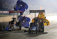 Sept. 3, 2011; Claremont, IN, USA: NHRA top fuel dragster driver T.J. Zizzo (left) alongside Cory McClenathan during qualifying for the US Nationals at Lucas Oil Raceway. Mandatory Credit: Mark J. Rebilas-