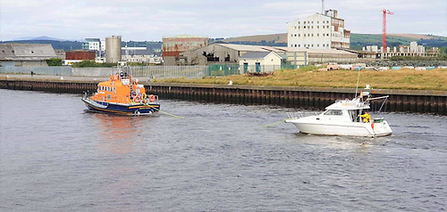 The all-weather lifeboat Ger Tighclearr tows the casualty vessel back to Arklow Harbour
