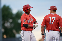 Batavia Muckdogs right fielder Jerar Encarnacion (27) on third base next to manager Mike Jacobs (17) during a game against the West Virginia Black Bears on June 19, 2018 at Dwyer Stadium in Batavia, New York.  West Virginia defeated Batavia 7-6.  (Mike Janes/Four Seam Images)