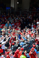 Cincinnati Reds fans look to catch a foul ball during a game against the Miami Marlins at Great American Ball Park on April 20, 2013 in Cincinnati, Ohio.  Cincinnati defeated Miami 3-2 in 13 innings.  (Mike Janes/Four Seam Images)