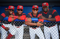 Batavia Muckdogs Samuel Castro (5), Marcos Rivera (8), Jhonny Santos (13), and Lazaro Alonso (19) in the dugout before a game against the Auburn Doubledays on June 19, 2017 at Dwyer Stadium in Batavia, New York.  Batavia defeated Auburn 8-2 in both teams opening game of the season.  (Mike Janes/Four Seam Images)