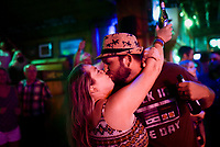 Amber Mills (from left) kisses Ira Mills, Saturday, July 17, 2021 at George's Majestic Lounge in Fayetteville. Check out nwaonline.com/210718Daily/ for today's photo gallery. <br /> (NWA Democrat-Gazette/Charlie Kaijo)