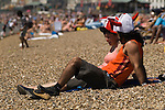 Football fans wearing funny English hats to celebrate World Cup English couple on the beach Southend on Sea Essex England 2006 2000s