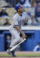 Moises Alou of the Chicago Cubs bats during a 2002 MLB season game against the Los Angeles Dodgers at Dodger Stadium, in Los Angeles, California. (Larry Goren/Four Seam Images)