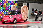 December 30, 2011, Tokyo, Japan - Visitors stand next to a car decorated with large ears during the 42nd Tokyo Motor Show. The show opens to the general public from December 3-11. (Photo by Christopher Jue/AFLO)2