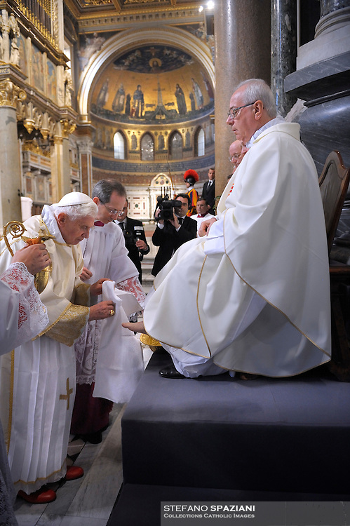Pope Benedict XVI washes 12 priests' feet during the evening mass commemorating Jesus' last supper with his 12 apostles on the evening before his Good Friday crucifixion at St Giovanni in Laterano Basilica in Rome, Italy on 21 April 2011.