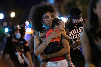 One and a half year old Bonita is held by her mother during a Black Lives Matter protest near the White House in Washington D.C., U.S., on Tuesday, June 23, 2020.  Trump tweeted that he authorized the Federal government to arrest any demonstrator caught vandalizing U.S. monuments, with a punishment of up to 10 years in prison.  Credit: Stefani Reynolds / CNP/AdMedia