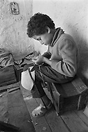 Children are employed to embroider on leather in Fez, Morocco - Child labor as seen around the world between 1979 and 1980 – Photographer Jean Pierre Laffont, touched by the suffering of child workers, chronicled their plight in 12 countries over the course of one year.  Laffont was awarded The World Press Award and Madeline Ross Award among many others for his work.