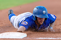 Kevin Kaczmarski (20) of the Las Vegas 51s dives back to first base during a game against the Oklahoma City Dodgers at Chickasaw Bricktown Ballpark on June 17, 2018 in Oklahoma City, Oklahoma. Oklahoma City defeated Las Vegas 5-3  (William Purnell/Four Seam Images)