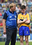 Seamus Clancy, Clare manager consoles Fergal Donnellan of Clare following their Minor Munster final at Killarney.  Photograph by John Kelly.