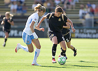 Christine Sinclair (right) controls the ball against Marian Dalmy (left). FC Gold Pride and Chicago Red Stars tied 1-1 at Buck Shaw Stadium in Santa Clara, California on June 7, 2009.