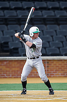 Aaron Bossi (17) of the Marshall Thundering Herd at bat against the Wake Forest Demon Deacons at Wake Forest Baseball Park on February 17, 2014 in Winston-Salem, North Carolina.  The Demon Deacons defeated the Thundering Herd 4-3.  (Brian Westerholt/Four Seam Images)