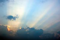 Sunbeams and clouds at sunrise from Li Jiang River, Limestone peaks and Li Jiang River at sunrise, Yangshuo, Guangxi, China.