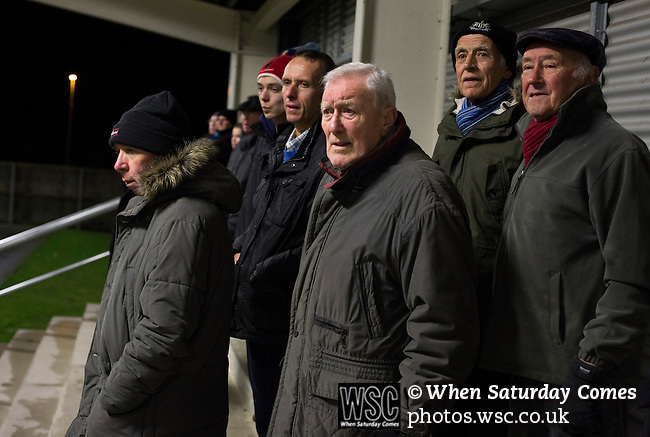 Bishop Auckland 3 West Auckland Town 1, 22/01/2016. Heritage Park, Northern League Division One. Home team supporters behind the goal in the first half watching the action as Bishop Auckland take on West Auckland Town in a Northern League division one match at Heritage Park. Bishop Auckland were winners of the Amateur Cup 10 times between 1895 and 1957 whilst their opponents won the Sir Thomas Lipton Trophy, regarded as the first world club tournament, in 1909 and 1911.  Bishop Auckland won this fixture 3-1, watched by a crowd of 422 at the ground they moved into in 2010. Photo by Colin McPherson.