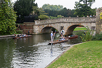 UK, England, Cambridge.  Punting on the River Cam, Clare Bridge in background.