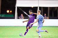 LAKE BUENA VISTA, FL - JULY 14: Antonio Carlos #25 of Orlando City SC kicks the ball during a game between Orlando City SC and New York City FC at Wide World of Sports on July 14, 2020 in Lake Buena Vista, Florida.
