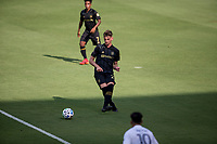 LOS ANGELES, CA - AUGUST 22: Tristan Blackmon #27 of LAFC passes off the ball during a game between Los Angeles Galaxy and Los Angeles FC at Banc of California Stadium on August 22, 2020 in Los Angeles, California.