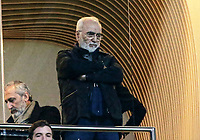 Pictured: PAOK owner Ivan Savvidis at Toumba Stadium in Thessaloniki, Greece. Sunday 25 February 2018<br /> Re: Sunday's Greek Super League derby between PAOK Thessaloniki and Olympiakos was called off after Olympiakos' manager Oscar Garcia was struck in the face by an object believed to be a till machine paper roll, thrown by a spectator minutes before kick-off.<br /> Garcia left Toumba Stadium for a local hospital to seek treatment for a bloodied lip.<br /> The incident prompted the Olympiakos team to leave the pitch in protest before riots erupted outside the ground.<br /> Angry PAOK fans leaving the stadium then clashed with police who used tear gas to quell the violence.