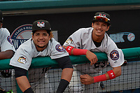 Tri-City ValleyCats Juan Paulino (16) and Deury Carrasco (23) in the dugout while in a fog delay during a NY-Penn League game against the Brooklyn Cyclones on August 17, 2019 at MCU Park in Brooklyn, New York.  Brooklyn defeated Tri-City 2-1.  (Mike Janes/Four Seam Images)