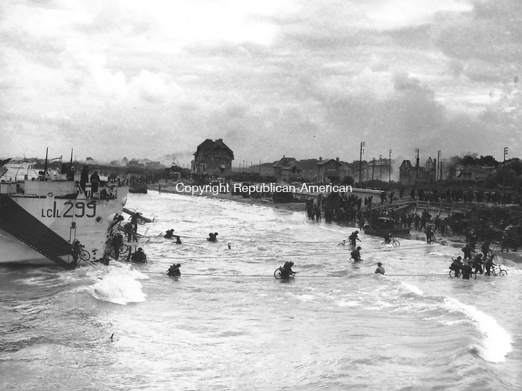 Soldiers of the 2nd Canadian Flotilla are carrying bicycles as they disembark their LCI's at a beachhead code-named Juno Beach, at Bernieres-sur-mer, during the Allied invasion of the Normandy on June 6, 1944, . (AP Photo)