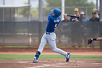 Los Angeles Dodgers outfielder James Outman (5) follows through on his swing during an Instructional League game against the Milwaukee Brewers at Maryvale Baseball Park on September 24, 2018 in Phoenix, Arizona. (Zachary Lucy/Four Seam Images)