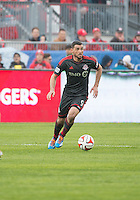 Toronto, Ontario - May 3, 2014: Toronto FC forward Gilberto #9 in action during a game between the New England Revolution and Toronto FC at BMO Field.<br /> The New England Revolution won 2-1.