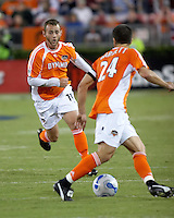 Houston Dynamo midfielder Brad Davis (11) prepares to receive a pass from teammate Wade Barrett (24).  Houston Dynamo beat CD Chivas USA 2-0 at Robertson Stadium in Houston, TX on October 29, 2006 to gain a berth in the Western Conference Final on a 3-2 aggregate.