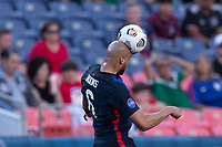 DENVER, CO - JUNE 3: John Brooks #6 of the United States heads a ball during a game between Honduras and USMNT at EMPOWER FIELD AT MILE HIGH on June 3, 2021 in Denver, Colorado.
