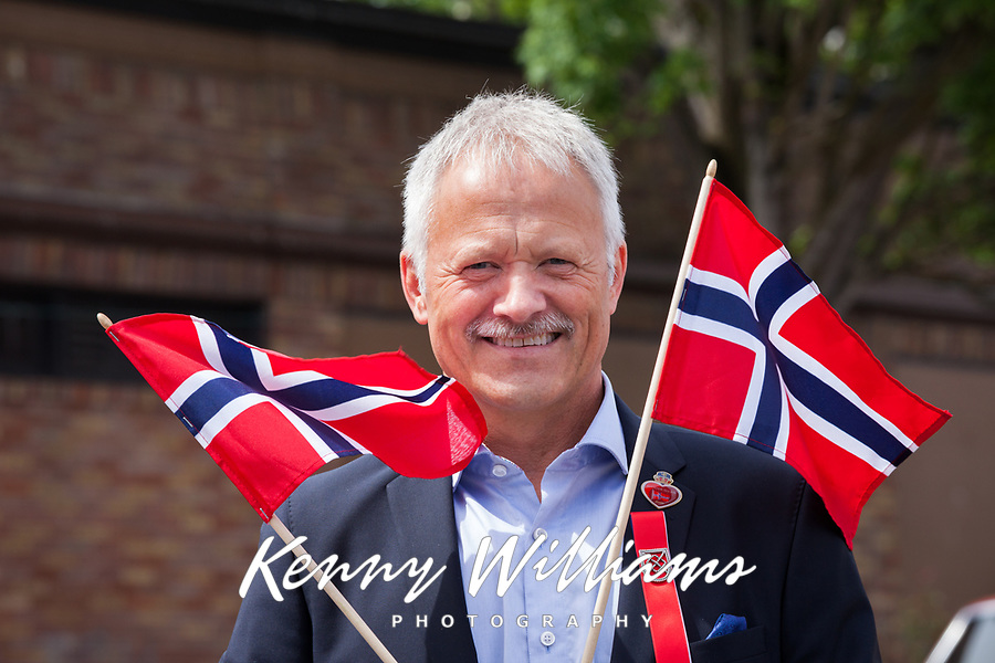Man waving Norweigan Flags, 17th of May Festival 2016, Norway's Constitution Day, Ballard, Seattle, WA, USA.