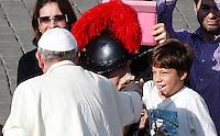 Papa Francesco saluta un bambino al termine di una messa in occasione della Giornata della Famiglia, in Piazza San Pietro, Citta' del Vaticano, 27 ottobre 2013.<br /> Pope Francis greets a child after celebrating a mass on the occasion of the Family Day, in St. Peter's Square at the Vatican, 27 October 2013.<br /> UPDATE IMAGES PRESS/Riccardo De Luca<br /> <br /> STRICTLY ONLY FOR EDITORIAL USE