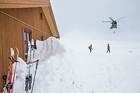 Soldiers receive firewood dropped off by helicopter. The newly built Vouma cabin in Dividalen National Park is part of the Norwegian Trekking Association network. As a goodwill gesture and part of their Arctic training the Royal Navy use helicopters to fly firewood to the remote location. <br /> <br /> <br /> In 2019 the Arctic exercise Clockwork passed 50 years of training in Norway, and now has a permanent base within the Norwegian Air Force base at Bardufoss. <br /> <br /> 845 Naval Air Squadron is a squadron of the Royal Navy's Fleet Air Arm. Part of the Commando Helicopter Force, it is a specialist amphibious unit operating the Leonardo Commando Merlin Mk3 helicopter and provides troop transport and load lifting support to 3 Commando Brigade Royal Marines.<br /> <br /> ©Fredrik Naumann/Felix Features