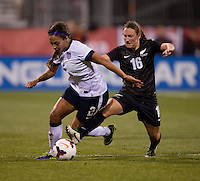 Sydney Leroux (2) of the USWNT sprints past Annalie Longo (16) of New Zealand during an international friendly at Crew Stadium in Columbus, OH. The USWNT tied New Zealand, 1-1.
