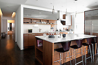 modern kitchen<br /> <br /> This upper West Side 2,200 sq ft coop apartment in New York City needed a full gut renovation but the owners, Shira and Michael Ronen had conflicting ideas of the style they wanted.  In order to keep both owners happy, architect Nicholas Karytinos managed to renovate the 3 bedroom apartment in a contemporary style while keeping the pre war character to the space.