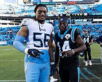 CHARLOTTE, NC - NOVEMBER 3: Sharif Finch #56 of the Tennessee Titans and Greg Dortch #14 of the Carolina Panthers after the game during a game between Tennessee Titans and Carolina Panthers at Bank of America Stadium on November 3, 2019 in Charlotte, North Carolina.