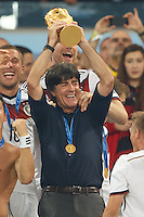 Germany manager Joachim Low celebrates winning the FIFA World Cup trophy with team mates