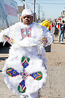 Terrance Pipkins, Spy Boy of the 7th Ward Creole Hunters, in the Treme neighborhood of New Orleans on Mardi Gras day, February 16, 2010.