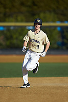 D.J. Poteet (4) of the Wake Forest Demon Deacons rounds the bases after hitting a home run against the Gardner-Webb Runnin' Bulldogs at David F. Couch Ballpark on February 18, 2018 in  Winston-Salem, North Carolina. The Demon Deacons defeated the Runnin' Bulldogs 8-4 in game one of a double-header.  (Brian Westerholt/Four Seam Images)