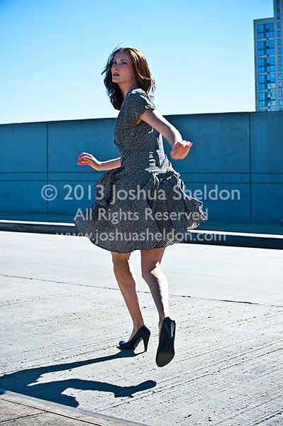 Woman running across street, rear view