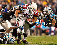 Four Carolina Panthers attempt to tackle Arizona Cardinals FB Terrelle Smith (45) during the NFC Divisional Playoff football game at Bank of America Stadium, in Charlotte, NC. Arizona defeated the Carolina Panthers 33-13.