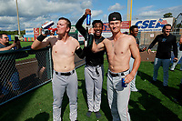 Batavia Muckdogs Troy Johnston (left), Edison Suriel (center), and Jack Strunc (right) celebrate after clinching the Pinckney Division Title during a NY-Penn League game against the Auburn Doubledays on September 2, 2019 at Falcon Park in Auburn, New York.  Batavia defeated Auburn 7-0 to clinch the Pinckney Division Title.  (Mike Janes/Four Seam Images)